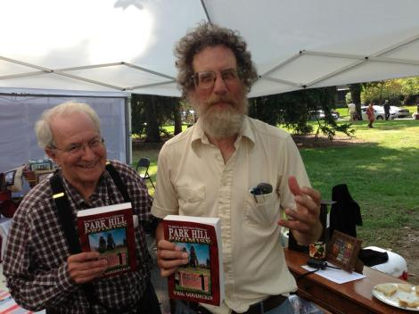Tom Torgove and Phil Goodstein (right) celebrate the release of Park Hill Promise at the 34th Annual Park Hill Home Tour on September 23. Goodstein wrote the book, while Torgove took the photos for it.  (GPHN Photo/Erin Vanderberg)