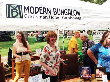 Kate Sultan, Street Fair coordinator and owner of Modern Bungalow, smiles between overseeing operations for the 34th Annual Park Hill Home Tour. (GPHN Photo/Erin Vanderberg)