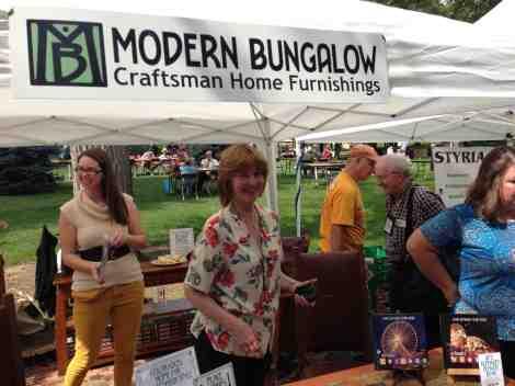 Kate Sultan, Street Fair Coordinator, mans her Modern Bungalow booth