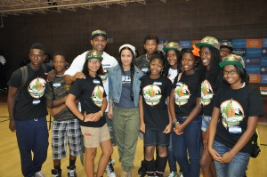 Contributed Photo/Brother Jeff FardTerrance Roberts, Executive Director of the Prodigal Son Initiative, Inc., stands with youth mentees at the Hiawatha Davis Recreation Center. Roberts' organization is scaling back their afterschool program to focus on working with youth in blighted communities.
